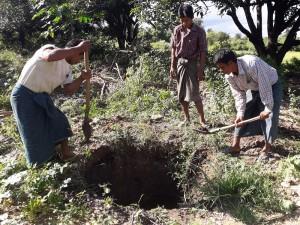 汚水槽のための穴を掘る村人